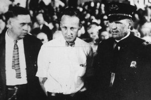 John Scopes being arrested for teaching evolution.